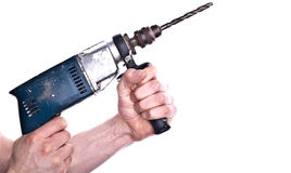 Hands holding power drill Stock Photography