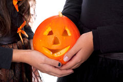 Hands holding pumpkin Royalty Free Stock Images