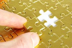 Hands holding a puzzle Royalty Free Stock Image