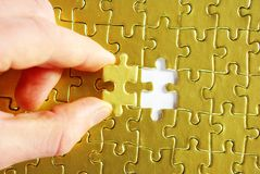 Hands holding a puzzle Royalty Free Stock Photography