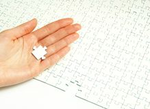 Hands holding  puzzle Royalty Free Stock Photography