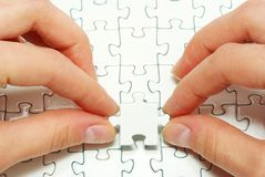 Hands holding puzzle. Hands holding a puzzle piece . business concepts Stock Photography