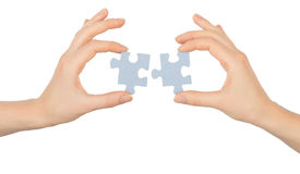 Hands holding puzzle pieces Royalty Free Stock Photos
