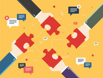 Hands holding puzzle pieces and message icons Royalty Free Stock Images