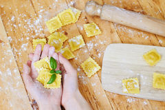 Hands holding ravioli pasta Stock Images