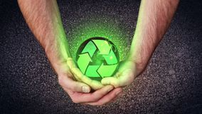 Hands holding a recycling symbol. Activating copy spaces stock footage