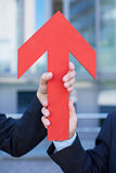 Hands holding red arrow Stock Image