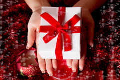 Hands holding red Christmas gift Stock Image
