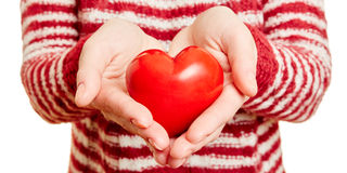 Hands holding a red heart Stock Photo