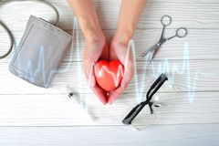 Hands holding red heart with medical injection. medical concept.  royalty free stock photos