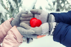 Hands holding red heart outdoor Stock Photo