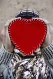 Hands holding red heart Stock Photography