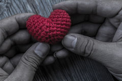 Hands Holding Red Heart Shaped Silk Stock Photo