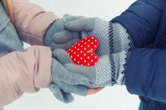 Hands holding red heart in winter Royalty Free Stock Photo