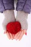 Hands holding a red heart Royalty Free Stock Photo