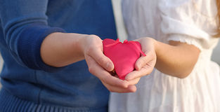 Hands holding red heart Stock Photos