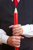 Hands holding red pencil Royalty Free Stock Photos