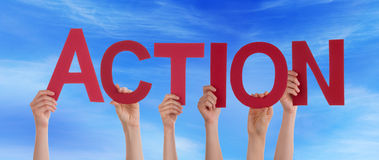 Hands Holding Red Straight Word Action Blue Sky. Many Caucasian People And Hands Holding Red Straight Letters Or Characters Building The English Word Action On Stock Images