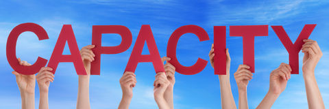 Hands Holding Red Straight Word Capacity Blue Sky Stock Image