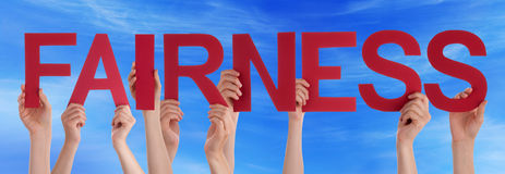 Hands Holding Red Straight Word Fairness Blue Sky Stock Photography