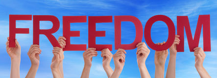 Hands Holding Red Straight Word Freedom Blue Sky Stock Images