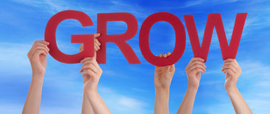 Hands Holding Red Straight Word Grow Blue Sky Stock Photography