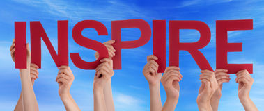Hands Holding Red Straight Word Inspire Blue Sky. Many Caucasian People And Hands Holding Red Straight Letters Or Characters Building The English Word Inspire On royalty free stock image
