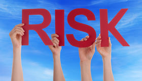Hands Holding Red Straight Word Risk Blue Sky Stock Photo