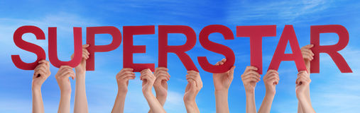 Hands Holding Red Straight Word Superstar Blue Sky Stock Photos