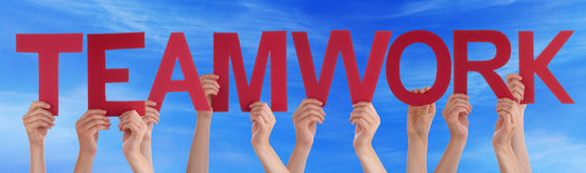 Hands Holding Red Straight Word Teamwork Blue Sky Stock Photography