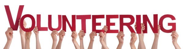 Hands Holding Red Straight Word Volunteering stock images