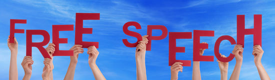 Hands Holding Red Word Free Speech Blue Sky Royalty Free Stock Photo