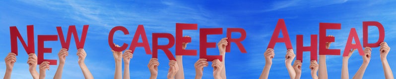 Hands Holding Red Word New Career Ahead Blue Sky. Many Caucasian People And Hands Holding Red Letters Or Characters Building The English Word New Career Ahead On Stock Images