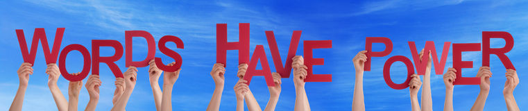 Hands Holding Red Word Words Have Power Blue Sky. Many Caucasian People And Hands Holding Red Letters Or Characters Building The English Word Words Have Power royalty free stock photo