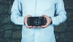 Hands holding retro camera. royalty free stock images