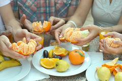 Hands holding ripe tangerine Royalty Free Stock Photo
