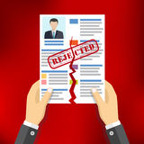 Hands holding ripped CV profile. Stock Photo