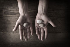 Hands holding rocks Royalty Free Stock Images