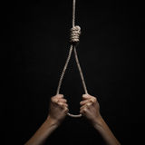 Hands holding rope slipknot in concept suicide Royalty Free Stock Images