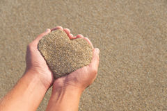 Hands holding a sand in form of heart Stock Photo