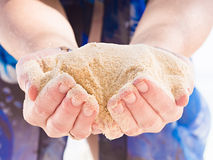 Hands holding sand Stock Photos