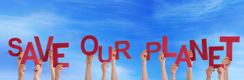Hands Holding Save Our Planet in the Sky. Many Hands Holding the Words Save Our Planet in the Sky Royalty Free Stock Photo