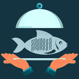 Hands holding a serving plate with the fish. The dish in the restaurant, a fish lunch royalty free illustration
