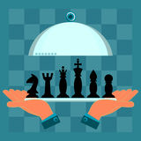 Hands holding a serving plate with a set of chess pieces. On a chess Board royalty free illustration