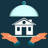 Hands holding a serving platter with house. Sale of real estate, a gift royalty free illustration