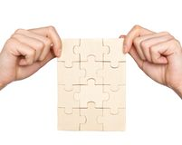 Hands holding set of puzzles Stock Photos