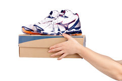Hands holding shoes in a box Stock Photo