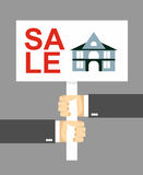 Hands holding a sign. House for sale Royalty Free Stock Images