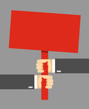 Hands holding a sign. Red sign. Royalty Free Stock Photo