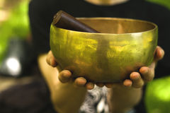 Hands holding a singing bowl Royalty Free Stock Photos